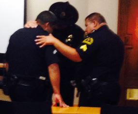 Officers praying together in Dallas