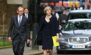 Small Theresa May with her husband