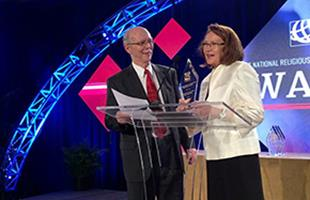 mi Laura Haukka receiving an award from Stan Jeter at a recent NRB Convention 07122016