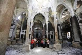 Coptic Christians pray at burned out church