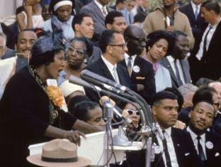 Mahalia Jackson singing at the March on Washington as Dr. King looks on