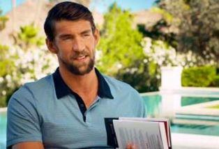 Michael Phelps holding copy of Purpose Drive Life