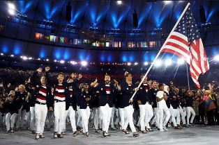 US team with Michael Phelps carrying the flag