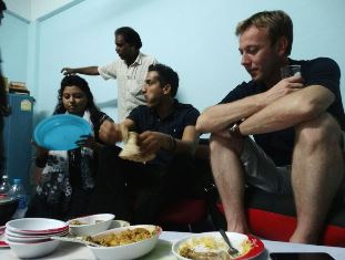 Wilson Chowdhry and Chris Rogers share meal with asylum seekers