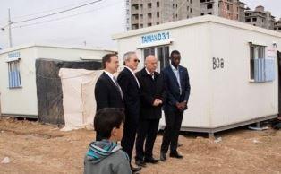 Officials post in front of new portacabins in Erbil