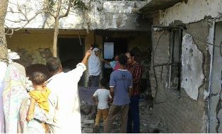 Outside damage to the home in Pakistan