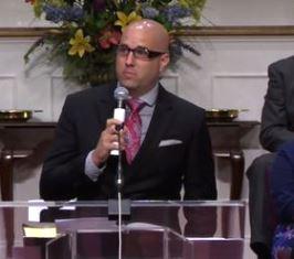 DR Harrison sharing his testimony