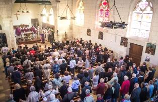 Small French church packed for ceremony