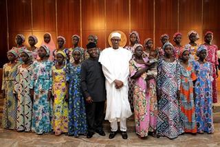 mi The released 21 Chibok girls met President Buhari in Abuja Oct. 19. 10 24 2016