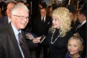 Dan Wooding with Dolly Parton at Movieguide awards