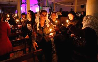 Assyrian Christians with candles