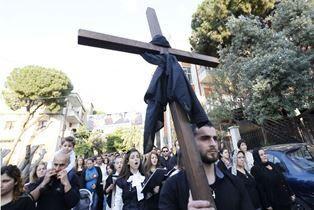 Assyrians carry cross