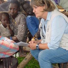 Baroness Cox talking with African children