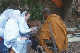 Bonnie on Tana Kirkos with one of the monks and the 1700 year old book