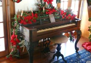 Piano decorated for Christmas