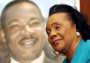 Coretta Scott King with her husband in background