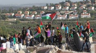 Palestinian youth protest Jewish settlements