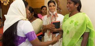 women visiting GFA church