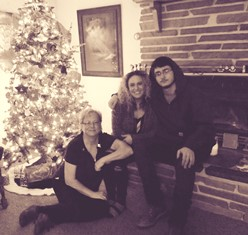Cathy with son and daughter at Christmas use
