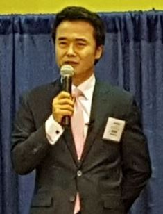 Johnny Kim speaking at the NRB