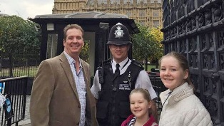 PC Palmer pictured with a family of tourists