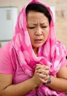 Woman praying GFA