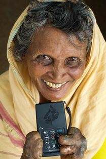 Lady who has suffered the indignities of leprosy holds her precious