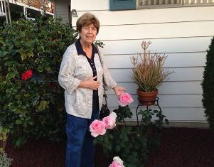 Norma outside our home with roses use