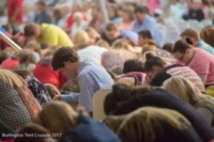 Prayer in the big tent
