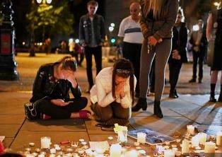 Two girls praying at vigil
