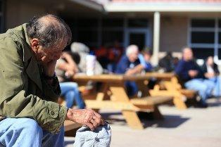 Homeless man in prayer