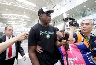 Rodman talks to the media