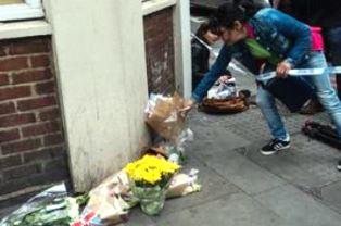 Woman leaves flowers in London