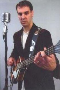 Chris Pick playing guitar