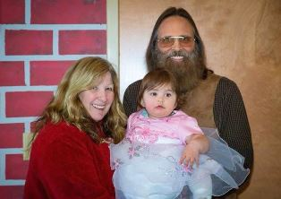John with wife and granddaughter
