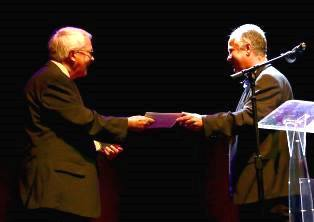 Peter Wooding hands award to Dan Wooding smaller