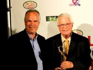 Peter and Dan with Love award
