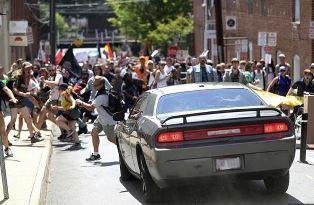 Car drives into protestors