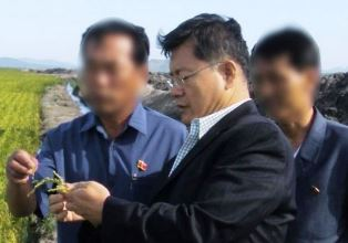 Lim at agricultural project in North Korea smaller