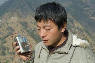 Listening to solar powered radio smaller