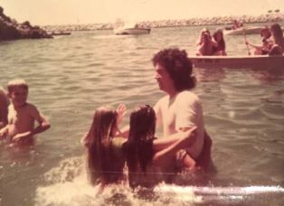 Bonnie being baptized by Tom Stipes in 1972