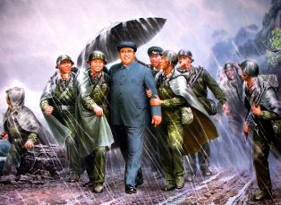 Kim Il sung leading troops