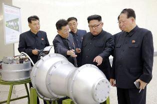 Kim Jong un looking at bomb