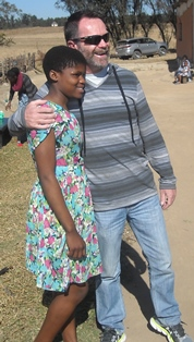 Steve with girl in Swaziland