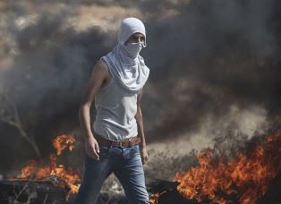 A Palestinian youth attacks Israeilis smaller