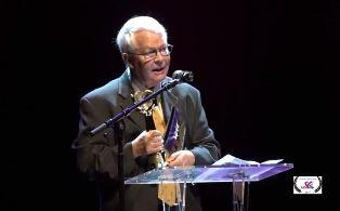 Dan Wooding speaking at film festival award ceremony smaller