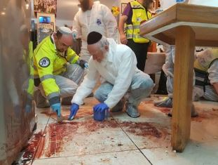 Jews mop up blood after attack