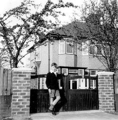 John Lennon outside the home of Aunt Mimi smaller