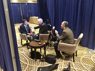 Peter Wooding filming Dan Wooding interviewing Dr Michael Youssef at NRB