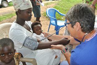 Sheila Leech treating child in Ghana 06 smaller